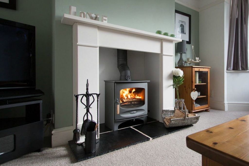 Freestanding stove with marble Fireplace