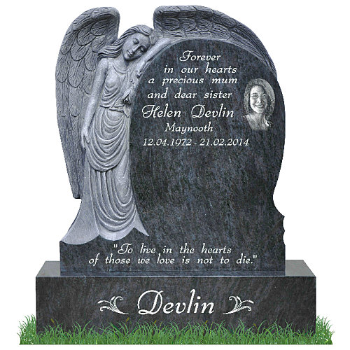 Hand carved grave memorial with photographs