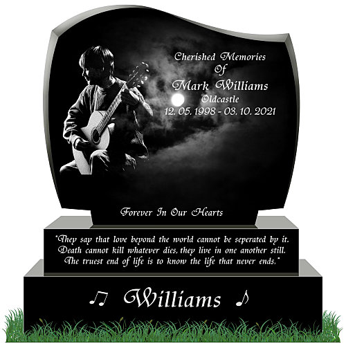Etched image of man and guitar on headstone