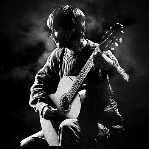 Laser etching of young man with guitar