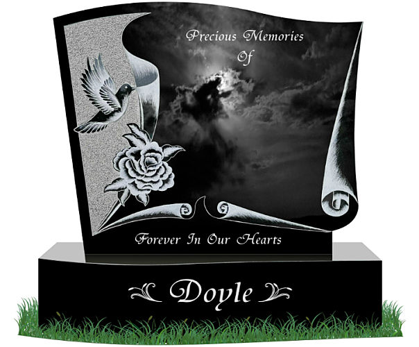 Present day headstone with dove etching in granite